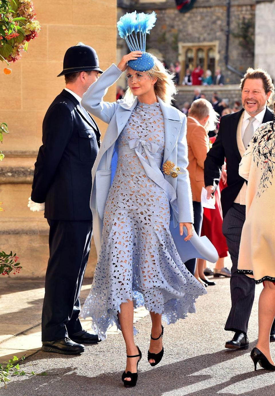 <p>Poppy Delevingne's pastel blue coat and lace dress combo complimented her blonde hair and bright red lip perfectly on Princess Eugenie and Jack Brooksbank's wedding day. </p>