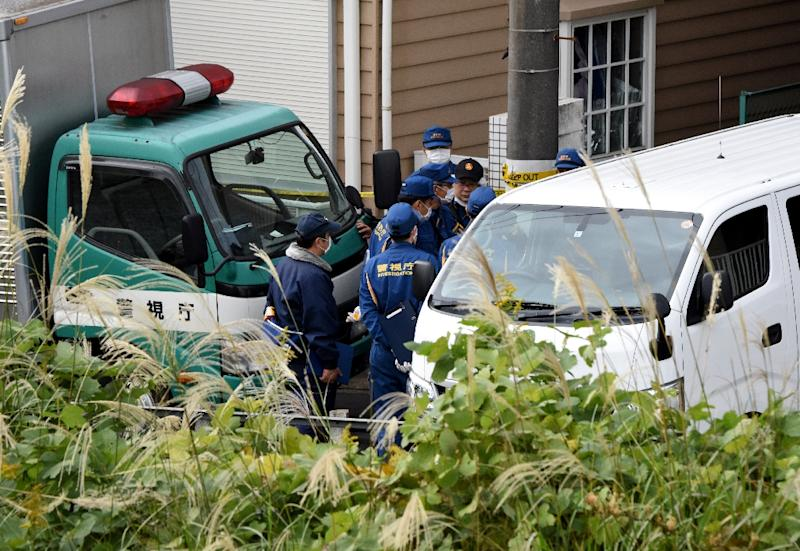 Police gather in front of the apartment (AFP Photo/Toru YAMANAKA)