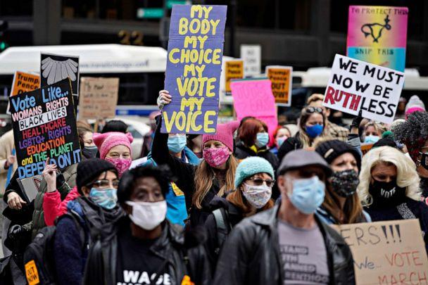 PHOTO: People march during the Women's March in downtown Chicago, Oct. 17, 2020. (Nam Y. Huh/AP)