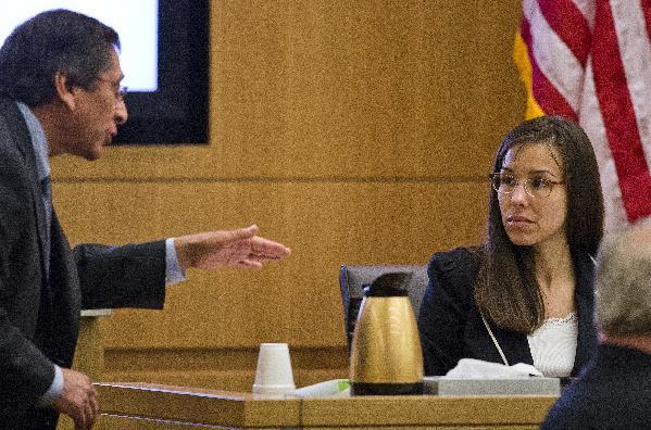 FILE - In this Feb. 21, 2013 file photo, Prosecutor Juan Martinez asks defendant Jodi Arias a question about her diary during cross examination testimony in Maricopa County Superior Court in Phoenix. Arias resumes testimony Monday, Feb. 25, 2013 in her Arizona murder trial after the start of a withering cross-examination last week by a prosecutor working to poke holes in her numerous stories. (AP Photo/The Arizona Republic, Tom Tingle, Pool)