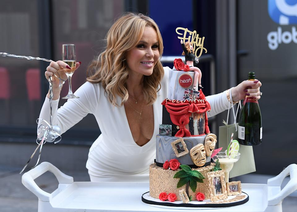 Amanda Holden posing with a special cake in honour of her birthday (Photo: Doug Peters/EMPICS Entertainment)
