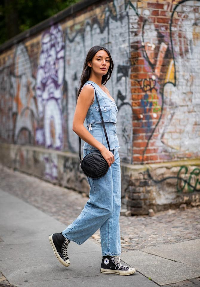 <p>Laid-back, blazing days call for a denim tank, jeans, and Converse sneakers. </p>
