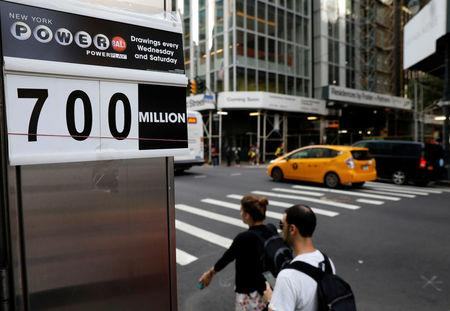 A sign displays that the Powerball jackpot is $700 million at a newsstand in New York City, U.S., August 23, 2017. REUTERS/Brendan McDermid