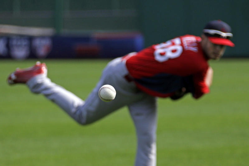 St. Louis Cardinals pitcher Joe Kelly (58) throws in the outfield at PNC Park during a baseball workout in Pittsburgh, Saturday, Oct. 5, 2013. Kelly is scheduled to start Game 3 of the National League division series against the Pittsburgh Pirates on Sunday. (AP Photo/Gene J. Puskar)