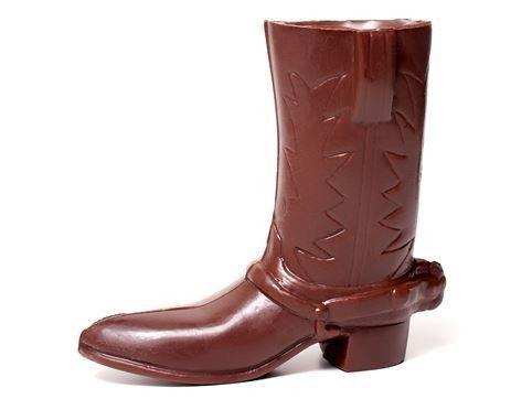 """<p>li-lacchocolates.com</p><p><strong>$38.00</strong></p><p><a href=""""https://www.li-lacchocolates.com/Chocolate-Specialty-Molds-Fashion-Cowboy-Boot"""" rel=""""nofollow noopener"""" target=""""_blank"""" data-ylk=""""slk:Shop Now"""" class=""""link rapid-noclick-resp"""">Shop Now</a></p><p>Sold in pairs of two and wrapped in gold packaging, these sweet, five-inch chocolate boots are every bit as wonderful as they look. He'll be saying, """"Yee-haw!"""" between bites.</p>"""