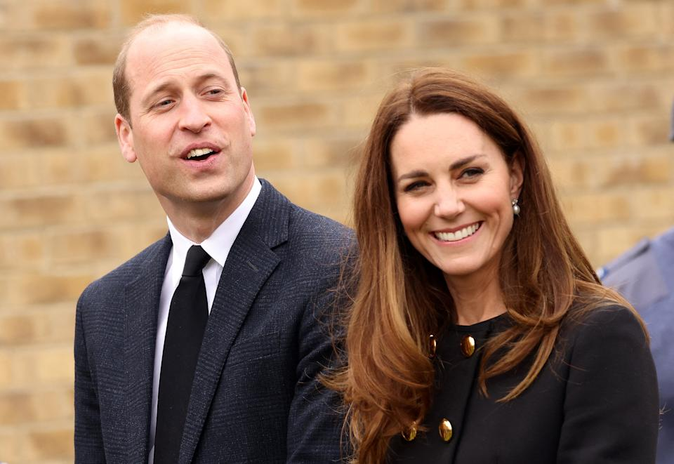Britain's Prince William, Duke of Cambridge, and Britain's Catherine, Duchess of Cambridge, wearing black as a mark of respect following the death of Britain's Prince Philip, Duke of Edinburgh, talk with Air Cadets during their visit to 282 (East Ham) Squadron Air Training Corps in east London on April 21, 2021