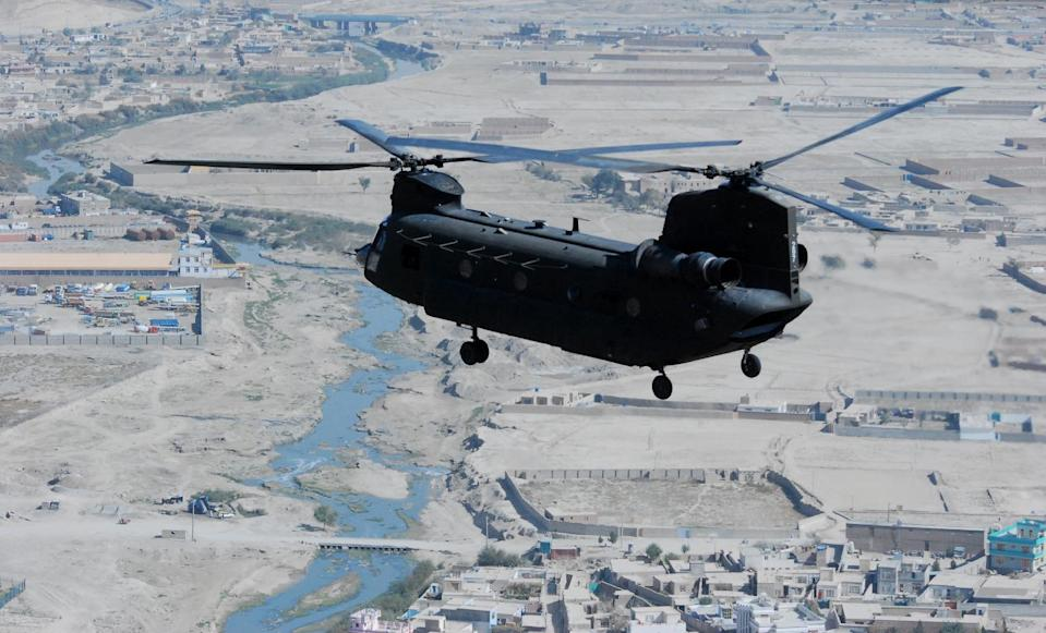 This handout photo provided by the US Army, taken Oct. 26, 2013, shows a 10th Combat Aviation Brigade CH-47 Chinook helicopter, operated by members of the Texas and Oklahoma National Guard, flying a personnel and equipment movement mission over Kabul, Afghanistan. To outfit Afghanistan's security forces with new helicopters, the Pentagon bypassed U.S. companies and turned instead to Moscow for dozens of Russian Mi-17 rotorcraft at a cost of more than $1 billion. Senior Pentagon officials assured skeptical members of Congress they'd made the right call, pointing repeatedly to a top-secret 2010 study they said named the Mi-17 as the superior choice. (AP Photo/Capt. Peter Smedberg, USCArmy)