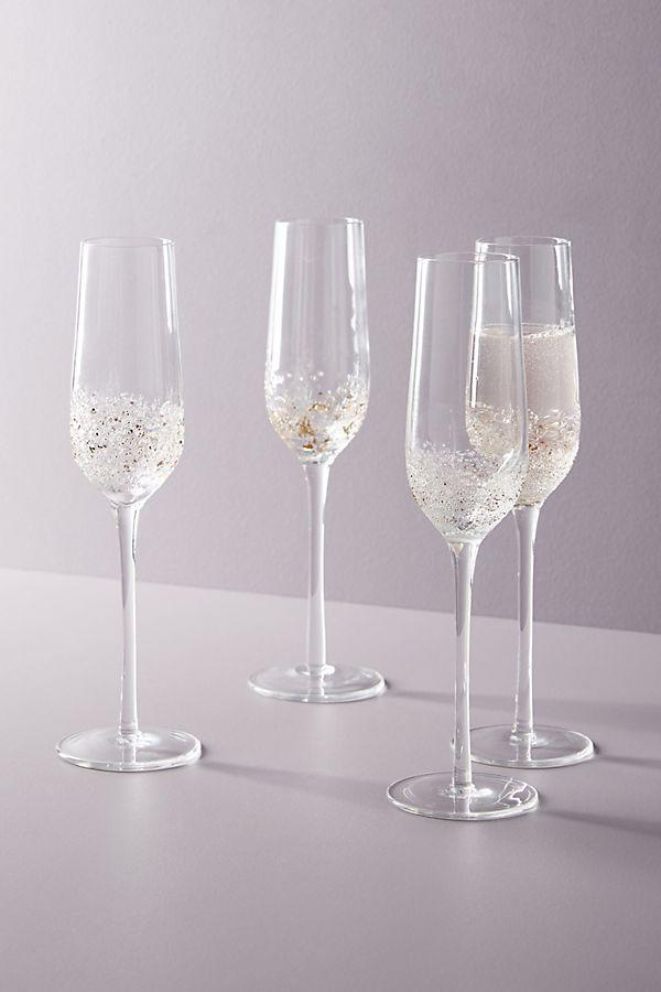 """<h3><a href=""""https://www.anthropologie.com/shop/volcania-flutes-set-of-4"""" rel=""""nofollow noopener"""" target=""""_blank"""" data-ylk=""""slk:Anthropologie Volcania Flutes, Set of 4"""" class=""""link rapid-noclick-resp"""">Anthropologie Volcania Flutes, Set of 4</a></h3><br>""""Of course, their drink of choice is champagne,"""" Stardust says. """"Gift your pal these lovely and chic champagne flutes for two for their birthday.""""<br><br><strong>Anthropologie</strong> Volcania Flutes, Set of 4, $, available at <a href=""""https://go.skimresources.com/?id=30283X879131&url=https%3A%2F%2Fwww.anthropologie.com%2Fshop%2Fvolcania-flutes-set-of-4"""" rel=""""nofollow noopener"""" target=""""_blank"""" data-ylk=""""slk:Anthropologie"""" class=""""link rapid-noclick-resp"""">Anthropologie</a>"""