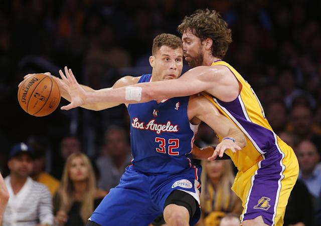 Los Angeles Clippers' Blake Griffin, left, controls the ball as Los Angeles Lakers Pau Gasol, of Spain, defends during the first half of an NBA basketball game in Los Angeles, Tuesday, Oct. 29, 2013. (AP Photo/Danny Moloshok)