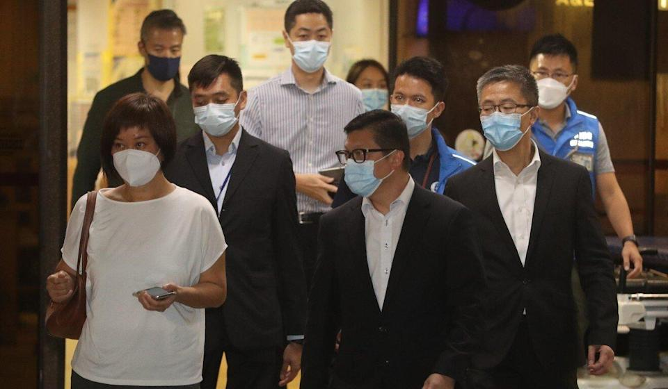 Security minister Chris Tang (front right) leaves Queen Mary Hospital after visiting the officer who was stabbed. Photo: Edmond So