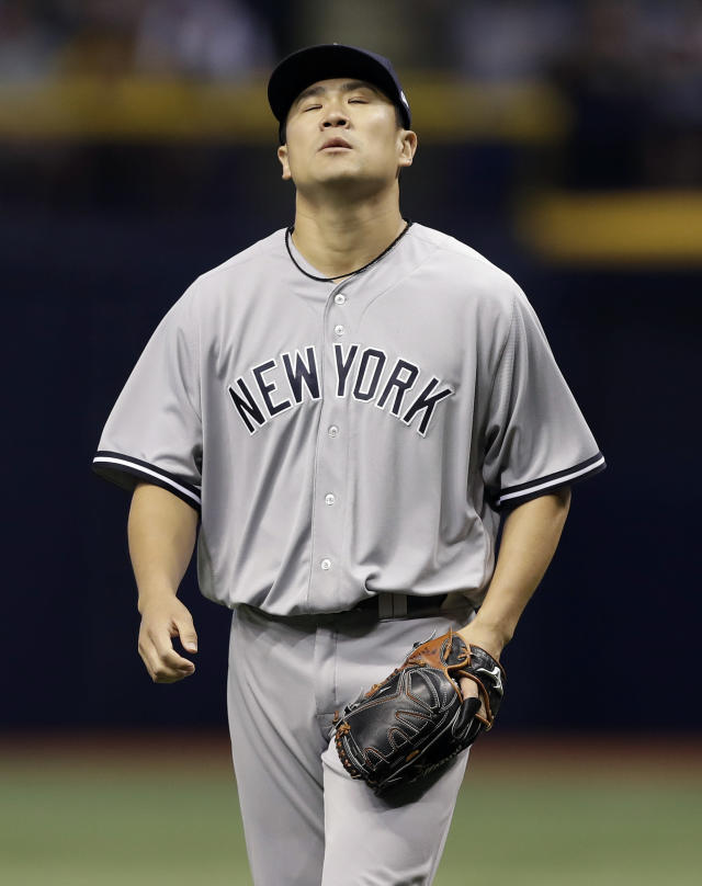 New York Yankees starting pitcher Masahiro Tanaka, of Japan, reacts after his throwing error on a ball hit by Tampa Bay Rays' C.J. Cron allowed Matt Duffy to score during the first inning of a baseball game Wednesday, Sept. 26, 2018, in St. Petersburg, Fla. (AP Photo/Chris O'Meara)