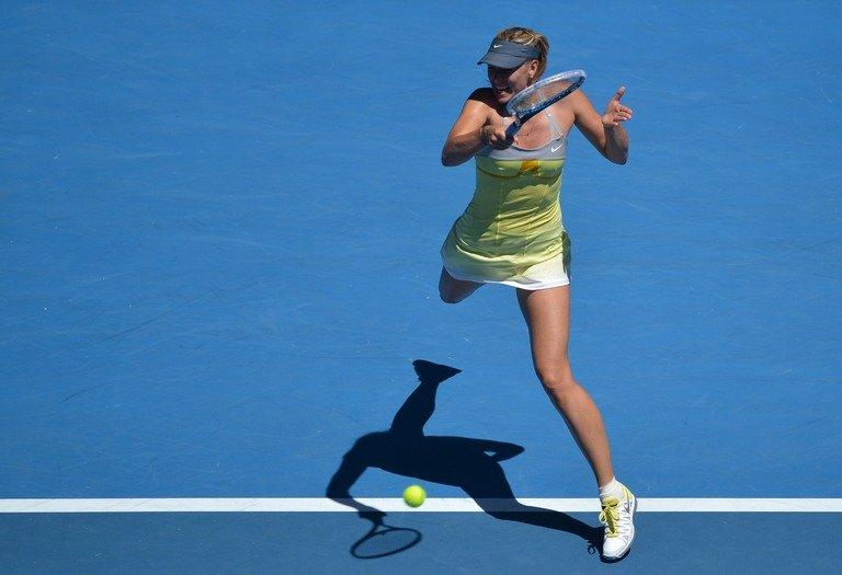 Maria Sharapova hits a return against China's Li Na during their semi-final at the Australian Open on January 24, 2013