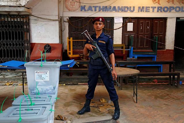 <p>A Nepalese policeman stands guard in front of sealed ballot boxes awaiting transportation, after the completion of the local election of municipalities and villages representatives in Kathmandu, Nepal, May 14, 2017. (Photo: Navesh Chitrakar/Reuters) </p>