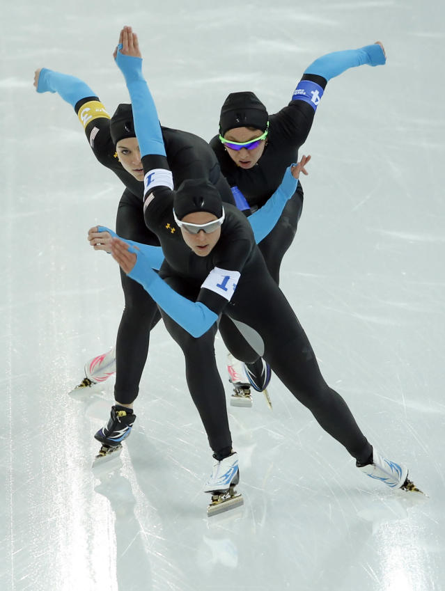 Speedskaters from the U.S. Brittany Bowe, Heather Richardson, and Jilleanne Rookard, front to rear, compete in the women's speedskating team pursuit quarterfinals at the Adler Arena Skating Center during the 2014 Winter Olympics in Sochi, Russia, Friday, Feb. 21, 2014. (AP Photo/Patrick Semansky)