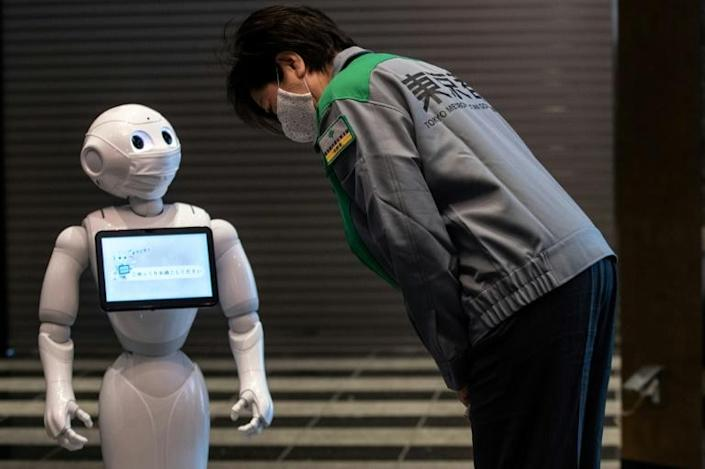 Humanoid robot Pepper will offer support and advice to patients in coronavirus quarantine at a Tokyo hotel (AFP Photo/Philip FONG)