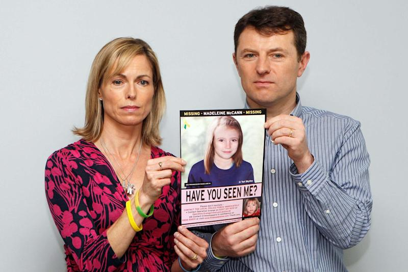 Kate and Gerry McCann hold a missing poster for Madeleine (REUTERS)