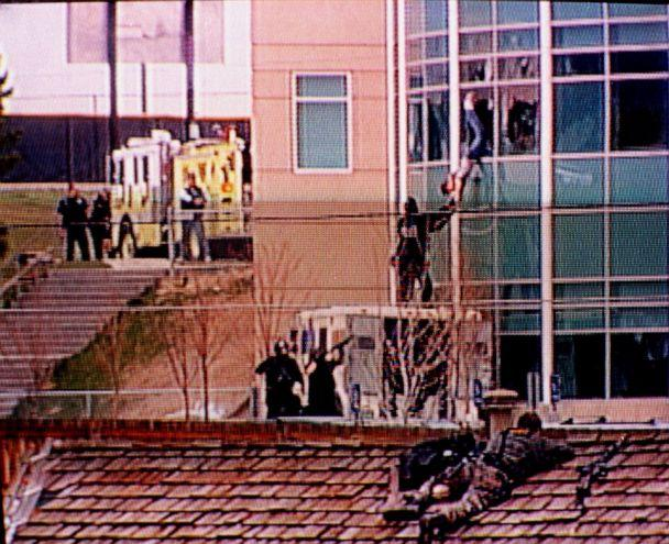 In this image from television, a Columbine High School student is rescued by emergency personnel during the shooting spree at the school in the southwest Denver suburb of Littleton, Colo., April 20, 1999. (KCNC-TV Denver via AP, FILE)
