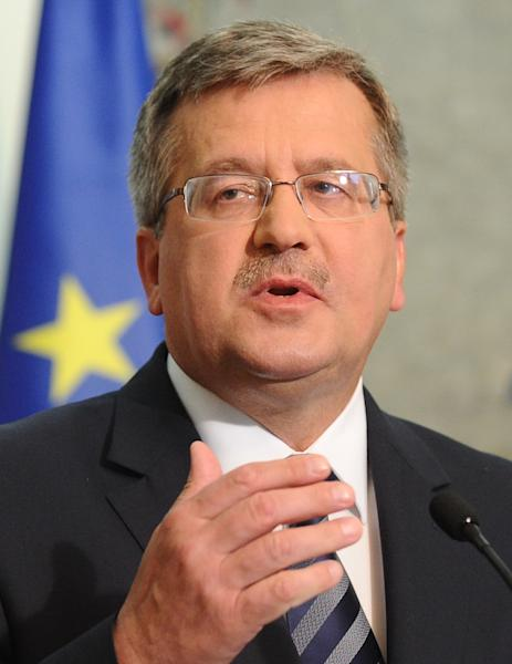 """Polish President Bronislaw Komorowski gestures during a press conference as he informs about U.S. President's Barack Obama letter, in Warsaw, Poland, Friday, June 1, 2012. Obama has written a letter to Komorowski expressing """"regret"""" for an inadvertent verbal gaffe that caused a storm controversy in Poland this week, after the U.S. President used the expression """"Polish death camp"""" , rather than """"Nazi death camp in German occupied Poland, while honoring a Polish WW II hero. (AP Photo/Alik Keplicz)"""