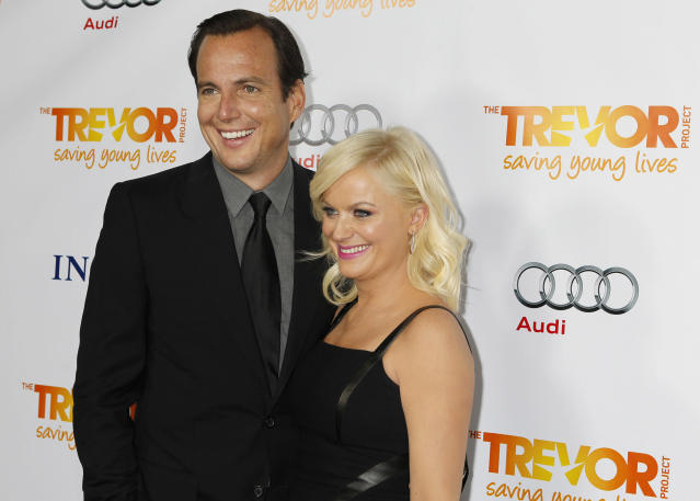 """Actor Will Arnett (L) and his wife actress Amy Poehler arrive at The Trevor Project's """"Trevor Live"""" fundraising dinner in Hollywood December 4, 2011. The Trevor Project provides crisis intervention and suicide prevention services to lesbian, gay, bisexual and transgender young people under the age of 24. REUTERS/Fred Prouser (UNITED STATES - Tags: ENTERTAINMENT SOCIETY)"""