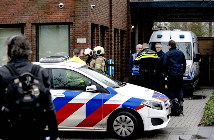 Dutch police and emergency personnel gather during the investigation of a suspicious letter which was delivered to Unisys Payment Services in Leusden on 13 February, 2020. Dutch police have arrested an alleged gang leader likened to 'El Chapo'.    (ANP/AFP via Getty Images)