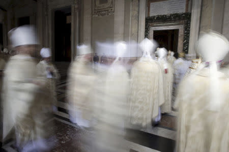 Cardinals walk in procession after Pope Francis opened the Holy Door to mark the opening of the Catholic Holy Year, or Jubilee, in St. Peter's Basilica, at the Vatican, in this December 8, 2015 file photo. REUTERS/Max Rossi/Files