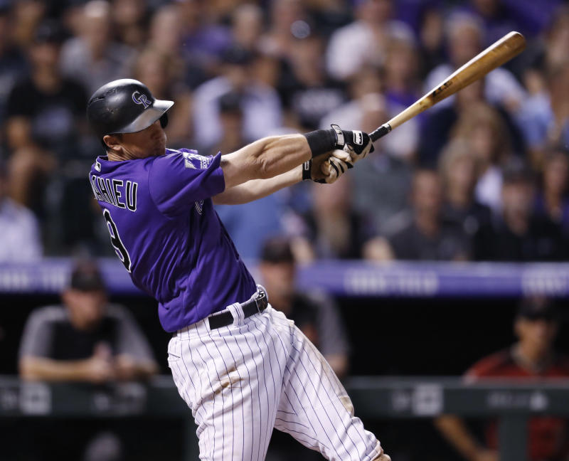 Colorado Rockies' DJ LeMahieu follows through with his swing after connecting for a two-run, walkoff home run off Arizona Diamondbacks relief pitcher Yoshihisa Hirano in the ninth inning of a baseball game Wednesday, Sept. 12, 2018, in Denver. The Rockies won 5-4. (AP Photo/David Zalubowski)