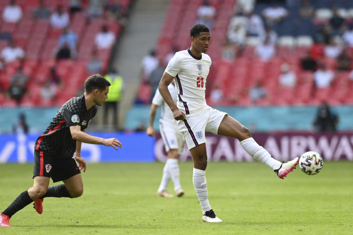 England's Jude Bellingham, right, plays the ball during the Euro 2020 soccer championship group D match between England and Croatia at Wembley stadium in London, Sunday, June 13, 2021. (Glyn Kirk/Pool Photo via AP)