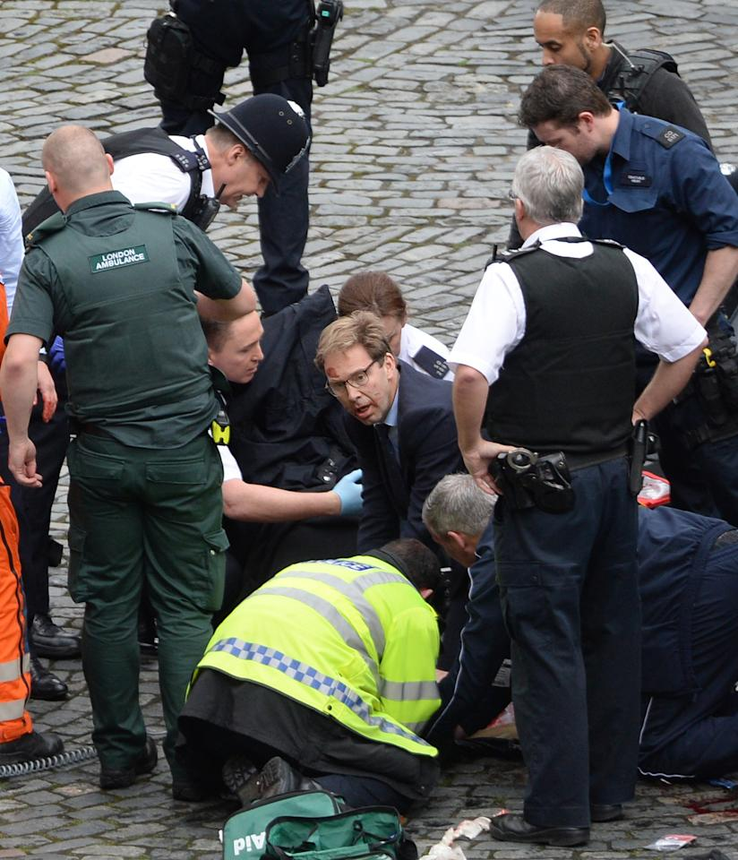 <p>On March 22, Khalid Masood drove through pedestrians on Westminster Bridge killing four people, before attacking a police officer outside the Palace of Westminster. Conservative MP Tobias Ellwood (centre), jumped into help PC Keith Palmer who tragically died from his injuries. (PA) </p>