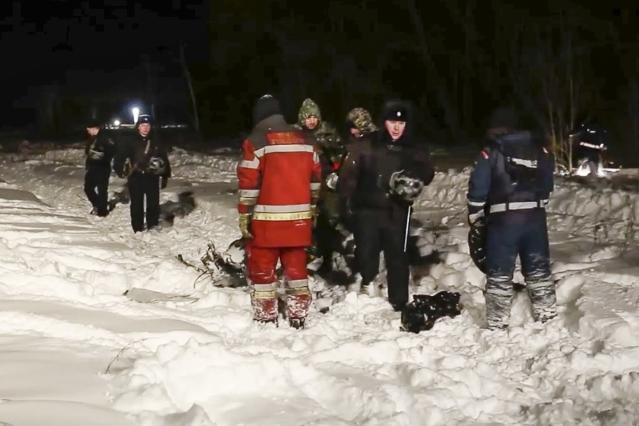 <p>In this photo provided by the Russian Emergency Situations Ministry, RMES employees and Russian police officers work at the scene of a AN-148 plane crash in Stepanovskoye village, about 40 kilometers (25 miles) from the Domodedovo airport, Russia, Feb. 11, 2018. A Russian passenger plane carrying 71 people crashed Sunday near Moscow, killing everyone aboard shortly after the jet took off from one of the city's airports. The Saratov Airlines regional jet disappeared from radar screens a few minutes after departing from Domodedovo Airport en route to Orsk, a city some 1,500 kilometers (1,000 miles) southeast of Moscow. (Russian Ministry for Emergency Situations photo via AP) </p>