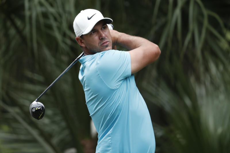 Brooks Koepka hits from the 11th tee during the first round of the RBC Heritage golf tournament, Thursday, June 18, 2020, in Hilton Head Island, S.C. (AP Photo/Gerry Broome)