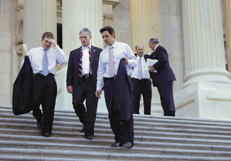 "Rep. Jim Jordan, R-Ohio, the Republican Study Committee chairman, far left, leaves the Capitol with fellow House GOP members after passage of the conservative deficit reduction plan known as ""Cut, Cap and Balance"" that prevailed 234-190, in Washington, Tuesday, July 19, 2011.  (AP Photo/J. Scott Applewhite)"