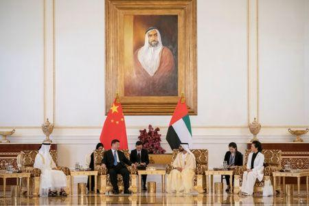 Prime Minister and Vice-President of the United Arab Emirates and ruler of Dubai Sheikh Mohammed bin Rashid al-Maktoum and Abu Dhabi's Crown Prince Sheikh Mohammed bin Zayed al-Nahyan meet with Chinese President Xi Jinping in Abu Dhabi, United Arab Emirates July 19, 2018.WAM/Handout via Reuters