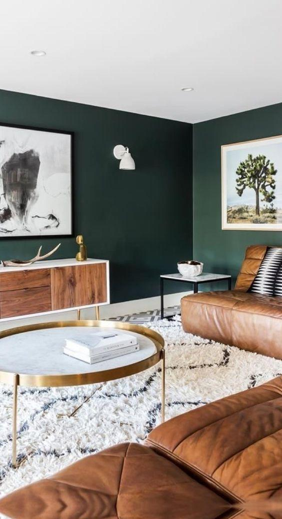 Living space with serene dark green walls.