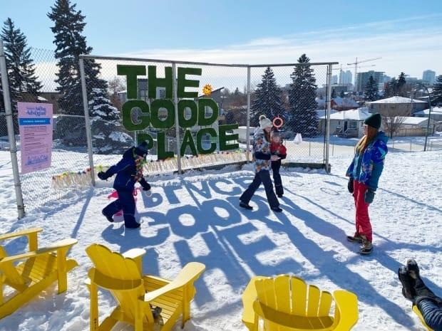 A team explores the Arctic Adventure's snow beach, which is equipped with deck chairs, a flamingo toss and 'chicken darts,' which involves throwing a rubber chicken into a target. (Submitted by the Bridgeland-Riverside Community Association - image credit)