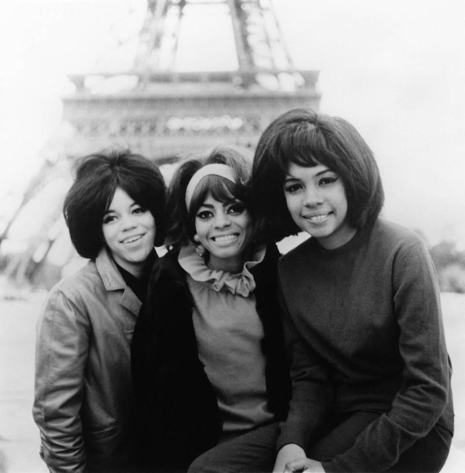 <p>The Supremes—which consisted of Florence Ballard, Diana Ross, and Mary Wilson, after Barbara Martin dropped out—smile for a snap in front of the Eiffel Tower in Paris. Ross sports a blouse with a ruffled collar and oversize earrings.<br></p>