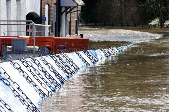 Temporary barriers have been overwhelmed by flood water in Bewdley (Getty Images)
