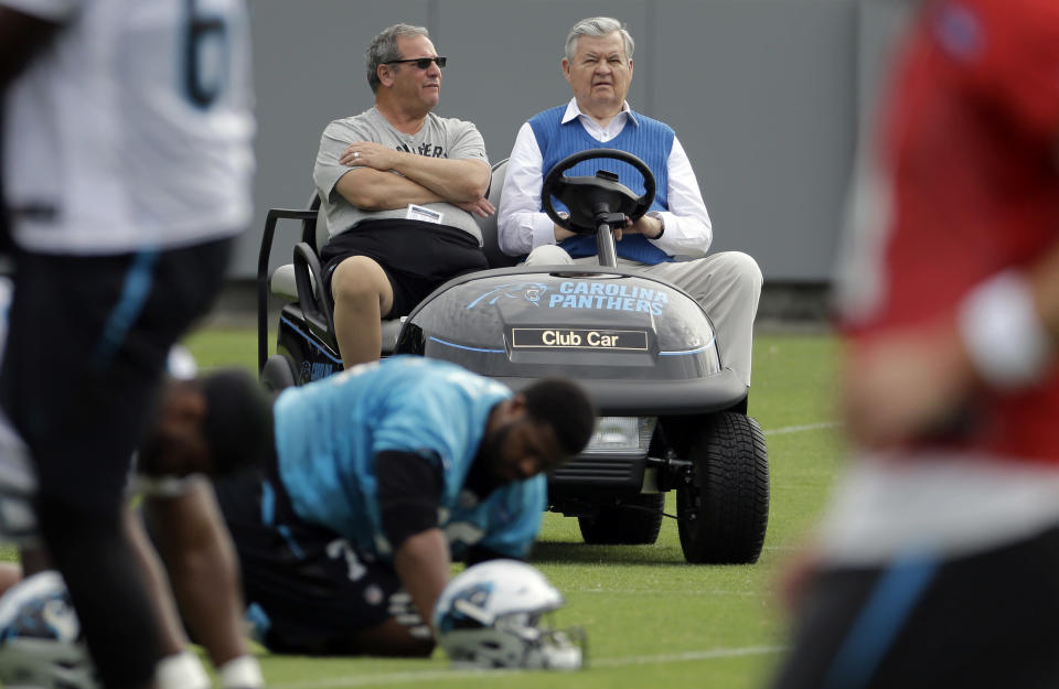 Carolina Panthers owner Jerry Richardson, right, is accused of numerous instances of sexual harassment as well as using a racial slur against one former employee. (AP)