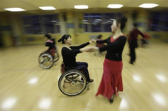 Physically disabled Liu Wei practices modern dance with her partner at a disabled persons activity center in Beijing, February 28, 2012.