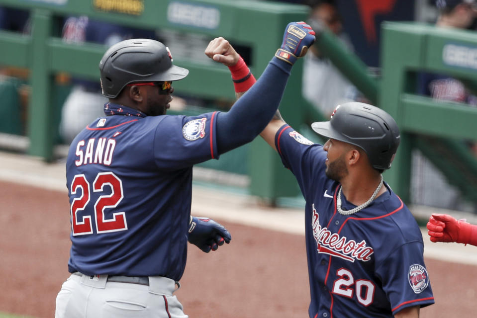 Minnesota Twins' Miguel Sano (22) celebrates with Eddie Rosario (20) after driving him and Jorge Polanco in with a three-run home run in the first inning of a baseball game against the Pittsburgh Pirates, Thursday, Aug. 6, 2020, in Pittsburgh. (AP Photo/Keith Srakocic)