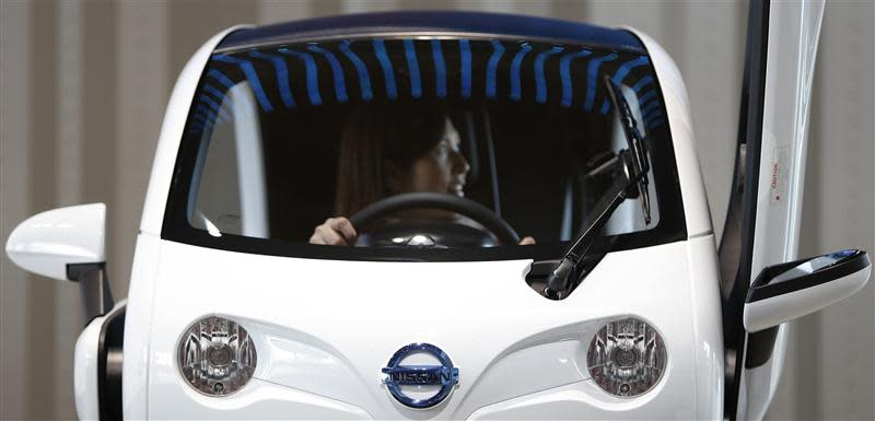 A visitor sits inside Nissan Motor Co's New Mobility concept car displayed at the company's showroom in Yokohama