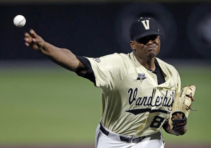 FILE - Vanderbilt's Kumar Rocker throws to a Duke batter during the eighth inning of an NCAA college baseball tournament super regional game in Nashville, Tenn., in this Saturday, June 8, 2019, file photo. Rocker threw a no-hitter in Vanderbilt's 3-0 victory. Vanderbilt returns most of its everyday lineup, features the top two pitchers in college baseball and won the most recent national championship. (AP Photo/Wade Payne, File)