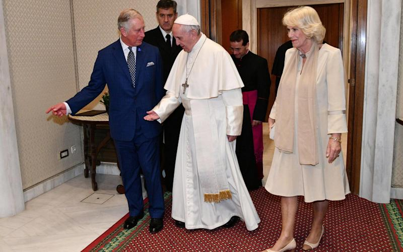 Pope Francis (C) meets with Prince Charles (L) and his wife Camilla, Duchess of Cornwall, for a private audience at the Vatican, 04 April 2017. The British royals are in Italy for a six-day visit as part of their European tour.  - Credit: AFP