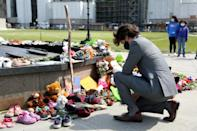 Canadian Prime Minister Justin Trudeau visits a makeshift memorial erected in Ottawa in honor of the 215 indigenous children whose remains found at a boarding school in British Columbia