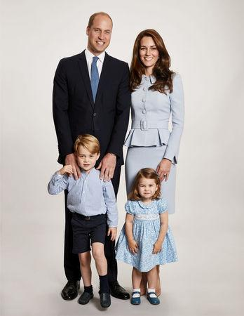 Britain's Prince William, Catherine, the Duchess of Cambridge and their two children Prince George and Princess Charlotte pose for a photograph at Kensington Palace for their 2017 Christmas card, London, Britain, December 18, 2017. Chris Jackson/Kensington Palace/Handout via REUTERS