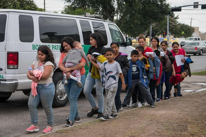 Central American migrant families arrive at a Catholic Charities respite center after being released from federal detention in McAllen, Texas.