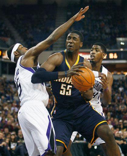 Indiana Pacers center Roy Hibbert (55) battles for position against Sacramento Kings defenders DeMarcus Cousins, left, and Jason Thompson during the first half of an NBA basketball game in Sacramento, Calif., on Wednesday, Jan. 18, 2012. (AP Photo/Steve Yeater)