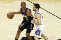 Phoenix Suns guard Chris Paul (3) is defended by Denver Nuggets guard Facundo Campazzo during the first half of Game 2 of an NBA basketball second-round playoff series, Wednesday, June 9, 2021, in Phoenix. (AP Photo/Matt York)