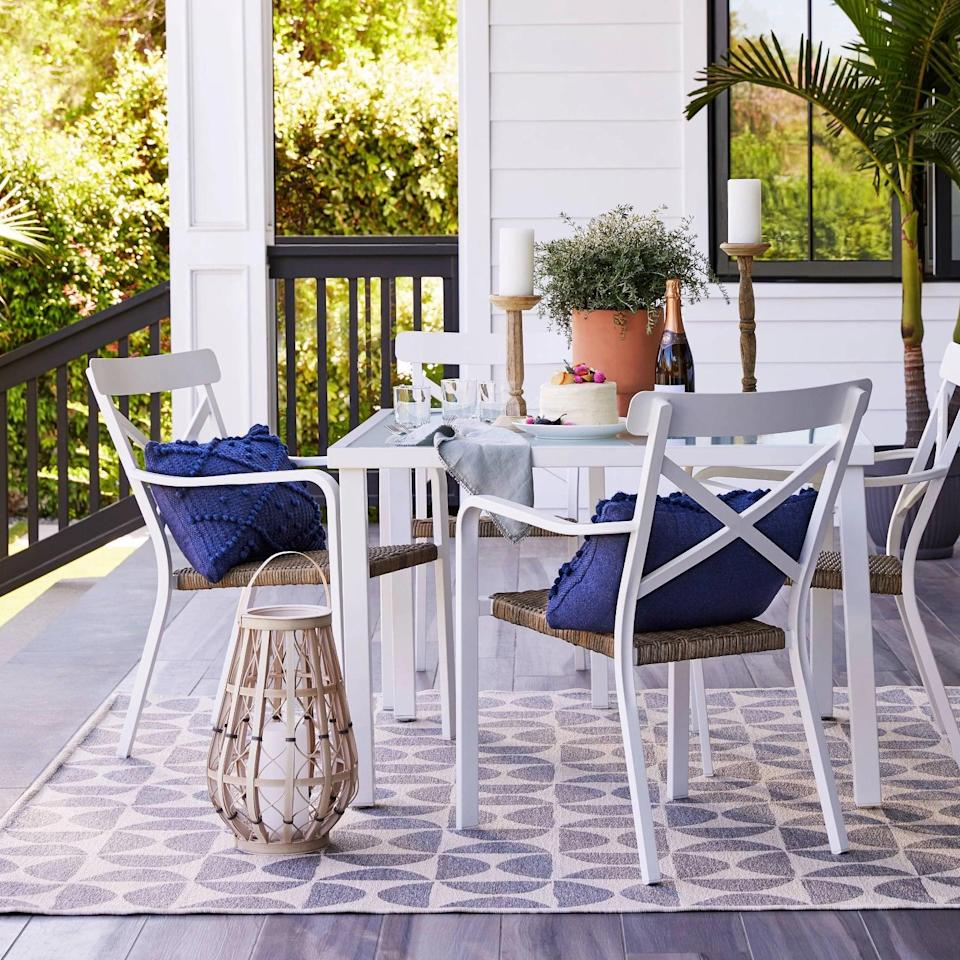 <p>Give your patio some coastal flair with the <span>Berkley Patio Dining Set</span> ($750).</p>