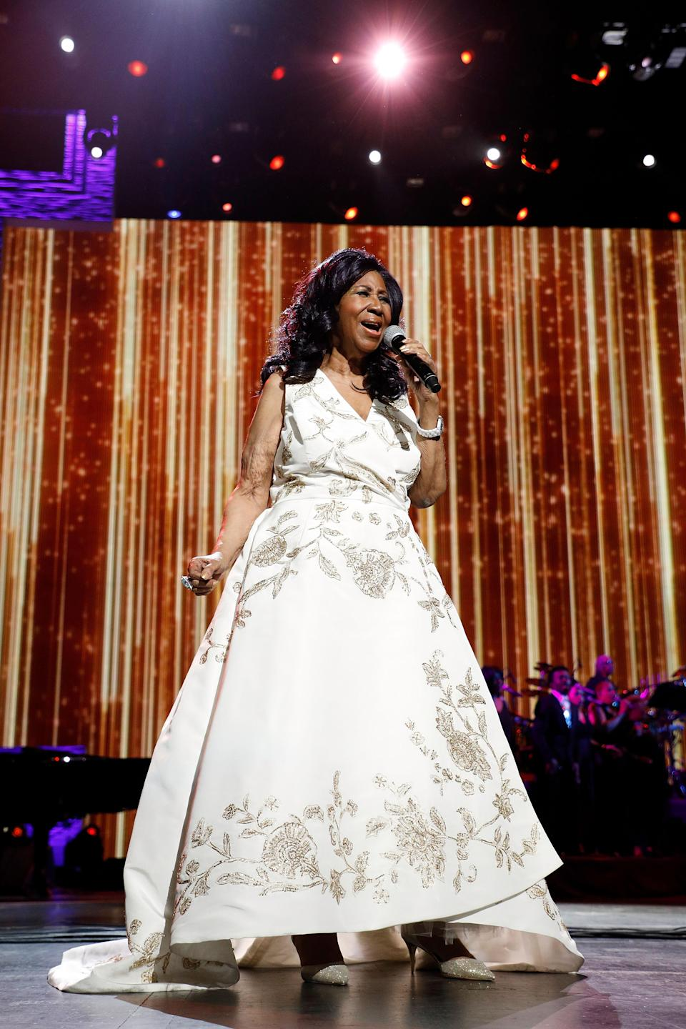 """<p>Aretha Franklin wearing a glamorous white and gold A-line gown while performing at the 2017 Tribeca Film Festival Opening Gala premiere of """"Clive Davis: The Soundtrack of Our Lives."""" (Photo by Taylor Hill/Getty Images) </p>"""