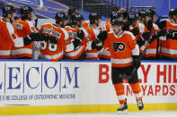 Philadelphia Flyers forward Scott Laughton (21) celebrates his goal during the second period of an NHL hockey game against the Buffalo Sabres, Saturday, Feb. 27, 2021, in Buffalo, N.Y. (AP Photo/Jeffrey T. Barnes)
